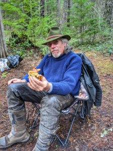 Vernon enjoying a hot lunch in the woods